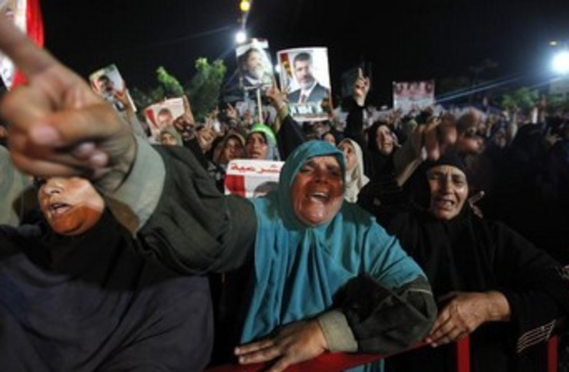 Female Morsi supporters yelling, pointing 370 (photo credit: REUTERS/Mohamed Abd El Ghany)