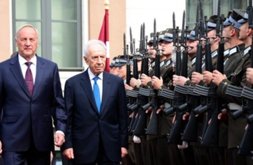 Israeli President Peres with Latvia President Riga (photo credit: GPO)
