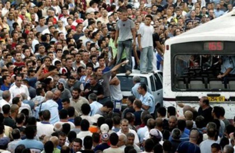 Shfaram bus 370 (photo credit: REUTERS/Alex Rozkovsky )