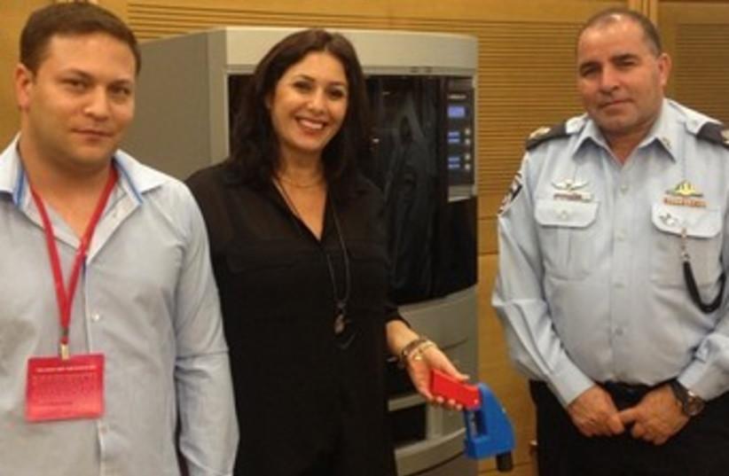 Miri Regev with a plastic gun 370 (photo credit: Knesset Spokesman's Office)