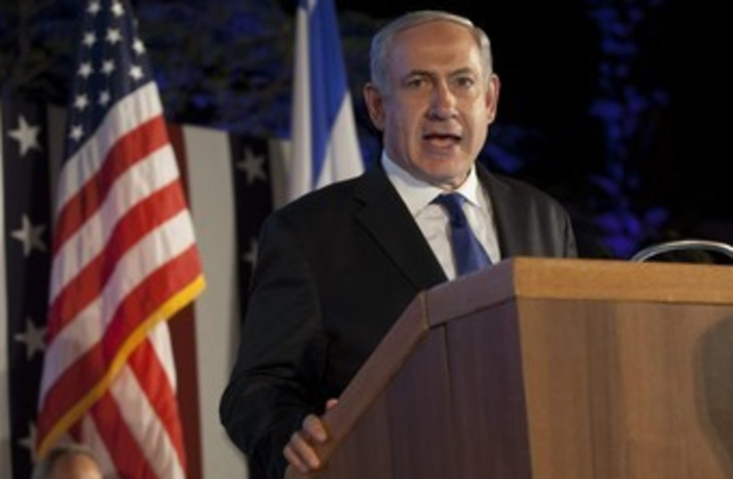 Netanyahu with American, Israeli flag USE THIS ONE390 (photo credit: מוטי מילרוד )