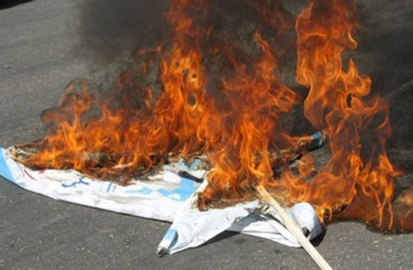 Al-Quds day Israel flag on fire in Iran 370 (photo credit: Wikimedia Commons)