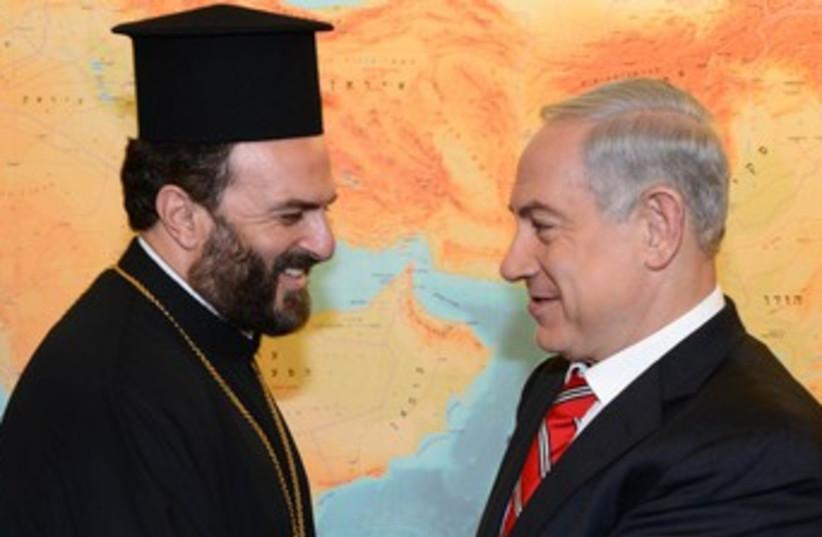 Netanyahu meets Father Gabriel Nadaf 370 (photo credit: Moshe Milner/GPO)