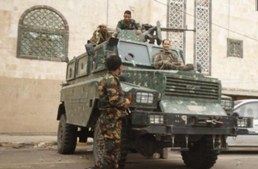 Police troopers secure a street in Sanaa 370 (photo credit: REUTERS/Khaled Abdullah)