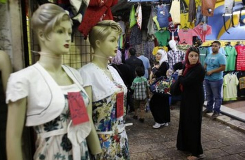 Palestinians shopping during Ramadan 390 (photo credit: REUTERS)
