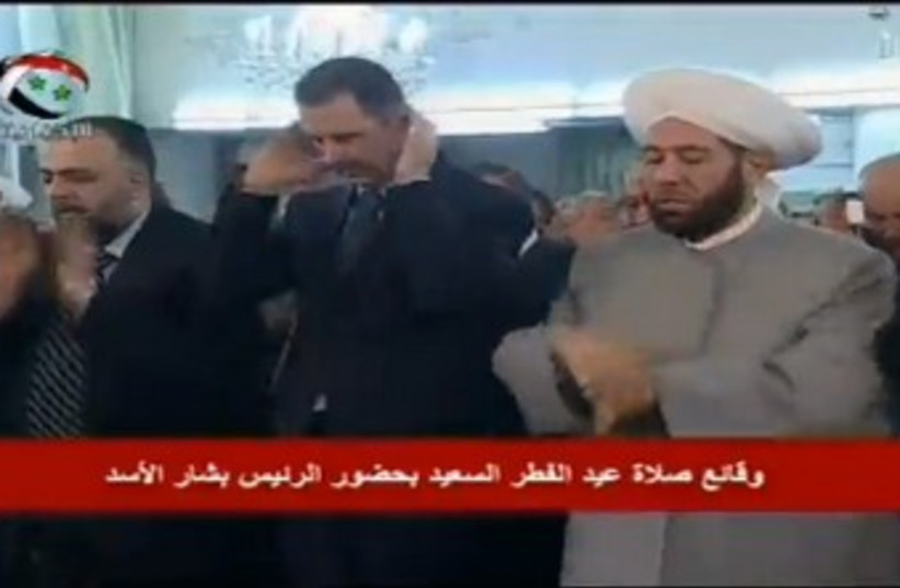 Assad attends Eid al-Fitr prayers 370 (photo credit: Syrian State Television)