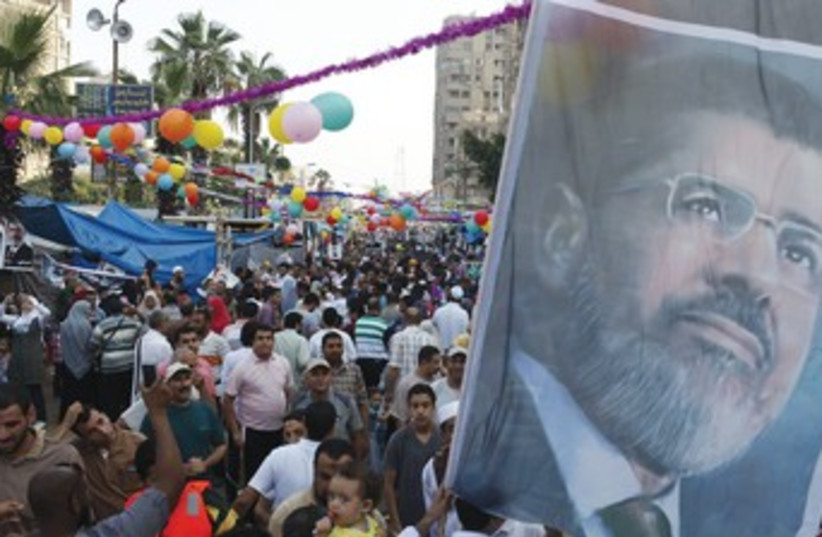 Morsi supporters gather in Cairo 370 (photo credit: Reuters)
