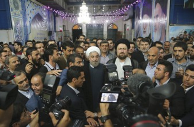 Rouhani in crowd 370 (photo credit: REUTERS)