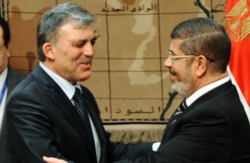Turkish President Gul with deposed Egyptian President Morsi  (photo credit: REUTERS)
