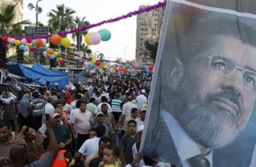 Morsi supporters in Rab'a al- Adawiya Square 370 (photo credit: REUTERS/Gil Cohen Magen)
