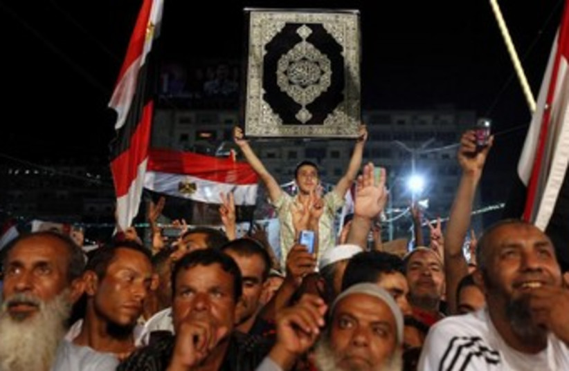 Morsi supporters night with Koran 370 (photo credit: REUTERS)
