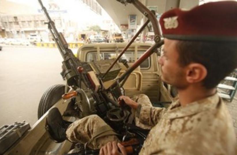 guard at yemen checkpoint 370 (photo credit: REUTERS)