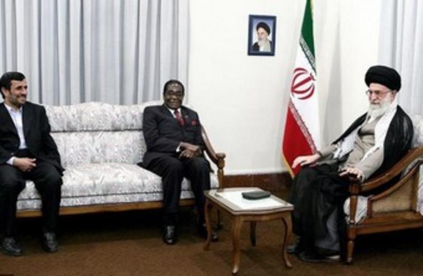Iran's Khamenei hosts Zimbabwean President Robert Mugabe in  (photo credit: REUTERS)