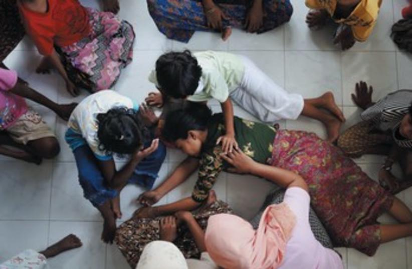 Muslim woman in Mayanmar 370 (photo credit: REUTERS)
