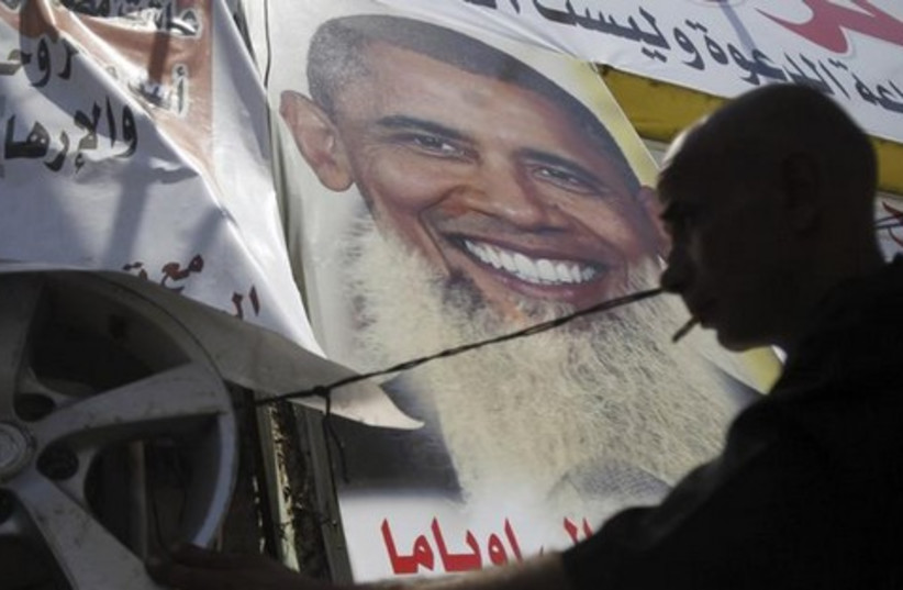 Poster depicting US president Barack Obama with a beard (photo credit: Reuters)