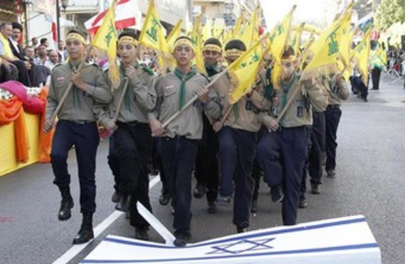 Hezbollah youth stomp on Israeli flag (photo credit: Reuters)