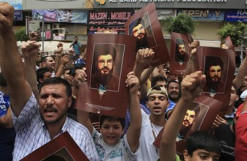 Supporters of Lebanon's Hezbollah leader Sayyed Hassan Nasra (photo credit: Reuters)