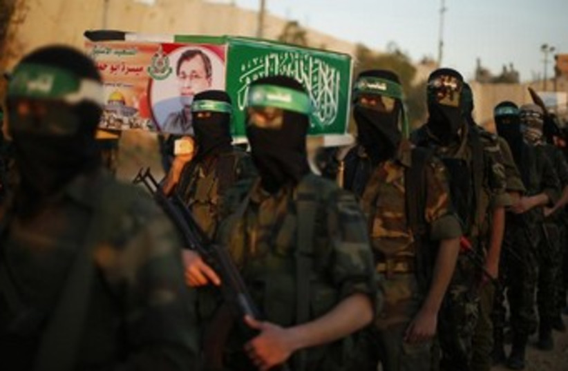 hamas men at funeral 370 (photo credit: REUTERS)