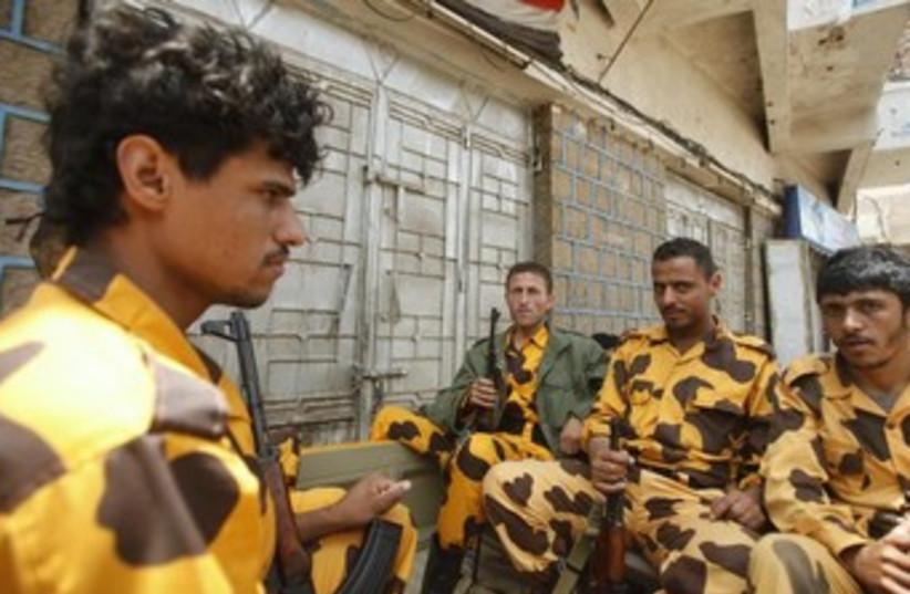 yemen policemen 370 (photo credit: REUTERS)
