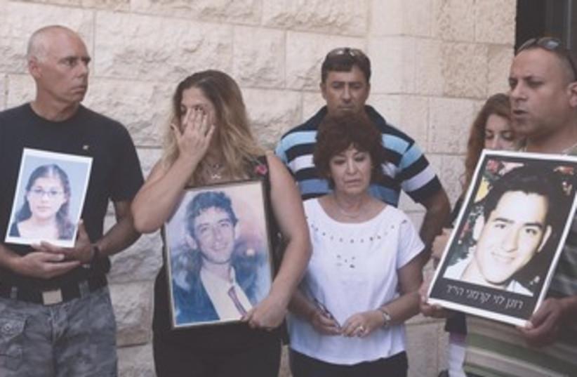 Bereaved families protest prisoner release outside Court 370 (photo credit: Marc Israel Sellem/The Jerusalem Post)