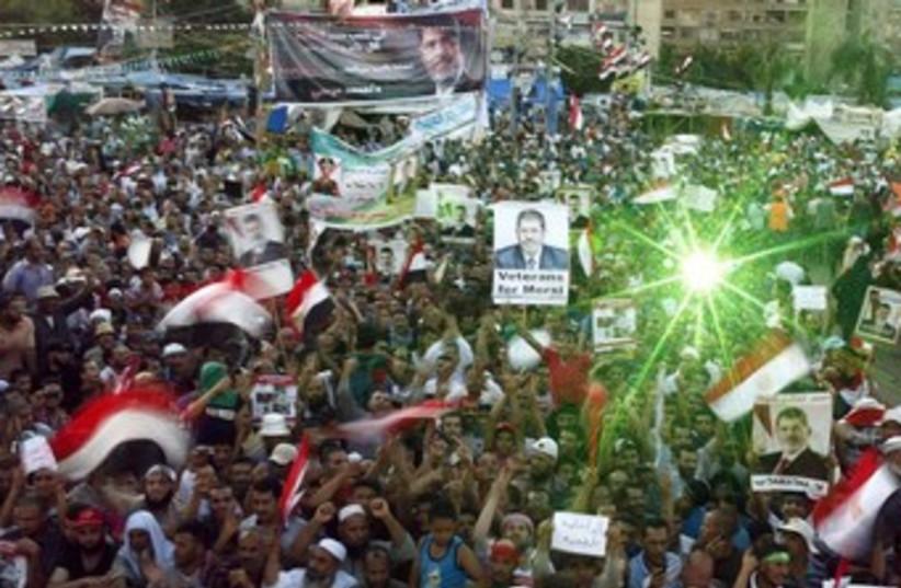 Pro Morsi supporters at Rabaa Adawiya Square 370 (photo credit: REUTERS/Asmaa Waguih)