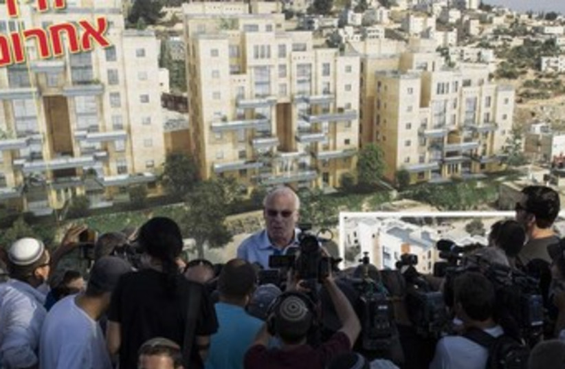 Uri Ariel speaking to reporters 370 (photo credit: REUTERS/Ronen Zvulun)