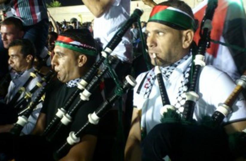Palestinians celebrate prisoner release 370 (photo credit: Ben Hartman)
