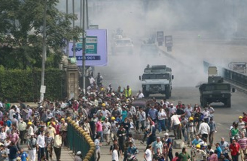 Protests near Cairo University 370 (photo credit: REUTERS)