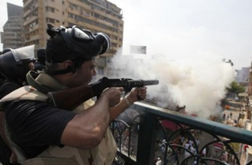 Riot police fire tear gas in Cairo 370 (photo credit: REUTERS)
