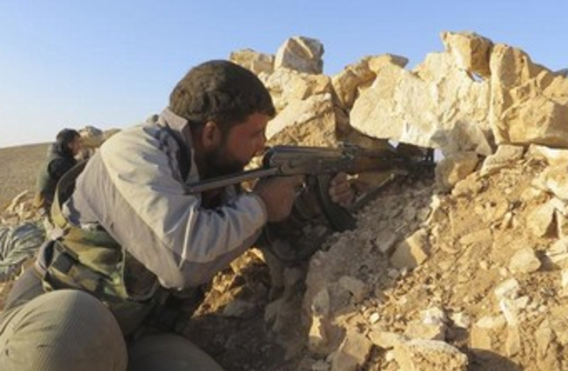 Free Syrian Army fighter in Deraa 370 (photo credit: REUTERS/Ali Abu Salah/Shaam News Network/Handout v)