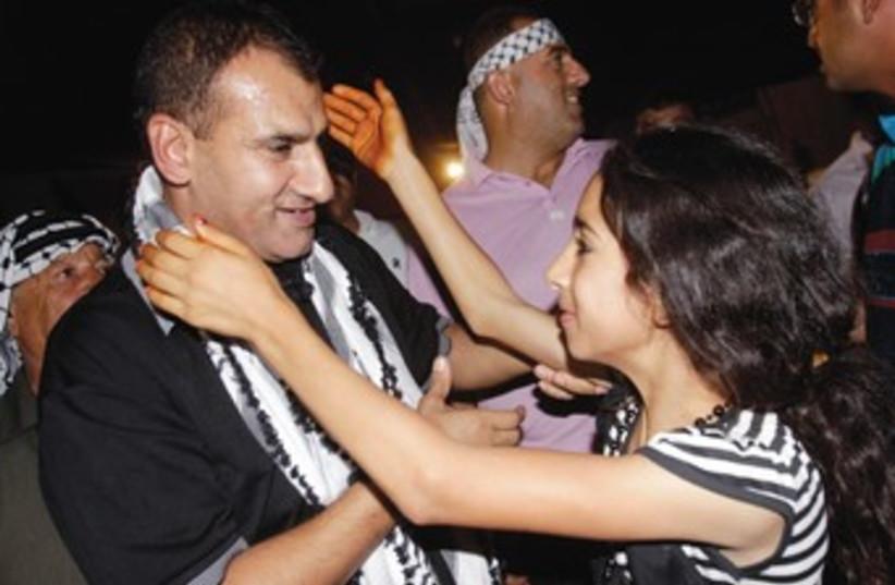 Freed Palestinian prisoner prisoner Hosni Sawalha 370 (photo credit: Abed Omar Qusini/Reuters)