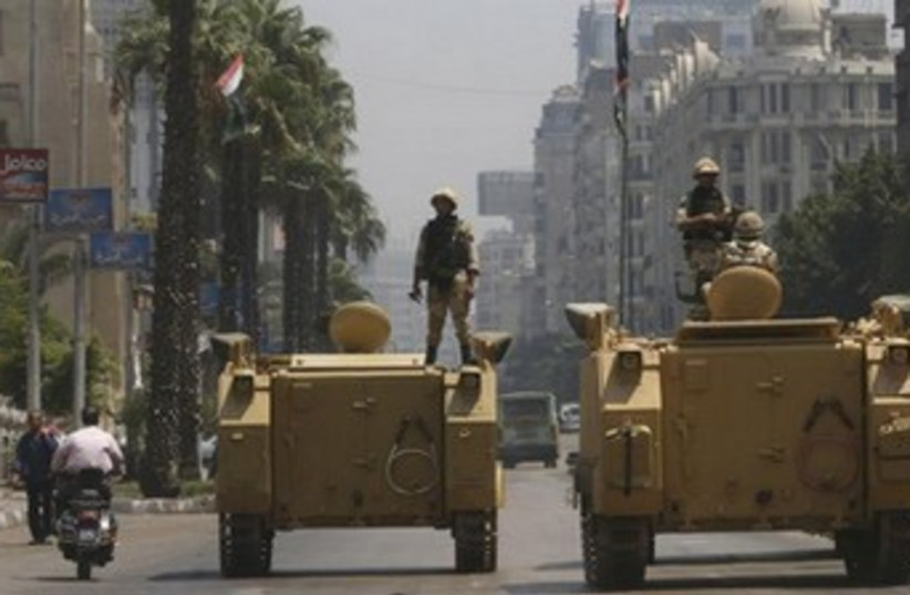 Egypt soldier on tank 370 (photo credit: REUTERS)