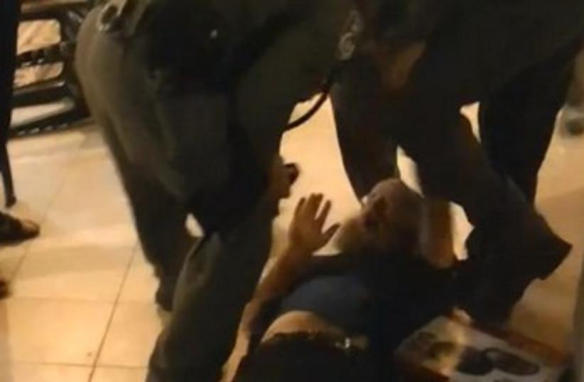 Yitzhar resident Boaz Albert arrest 370 (photo credit: YouTube Screenshot)