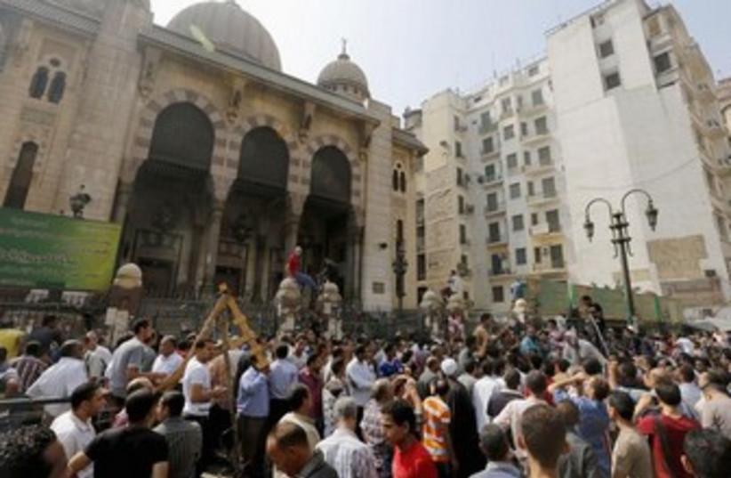 Anti-Morsi protesters gather near Al-Fath mosque in Cairo 37 (photo credit: Reuters)