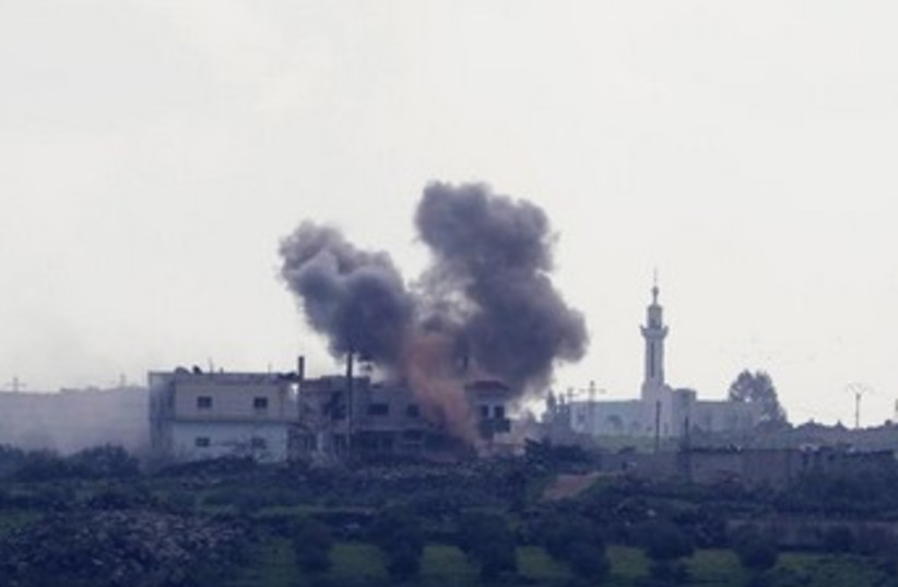 Shell explosion in Syria 370 (photo credit: REUTERS/Baz Ratner)