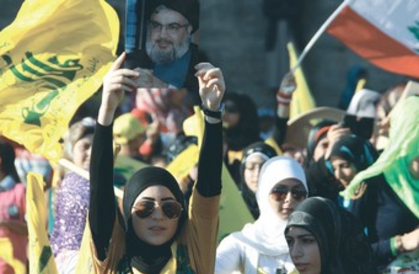 Hezbollah supporters rally in south Lebanon 350 (photo credit: REUTERS)