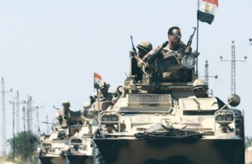Egyptian troops en route to Sinai 370 (photo credit: REUTERS)