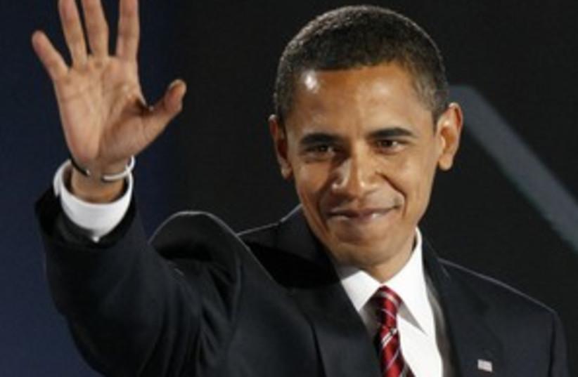 Obama salut (photo credit: AP)