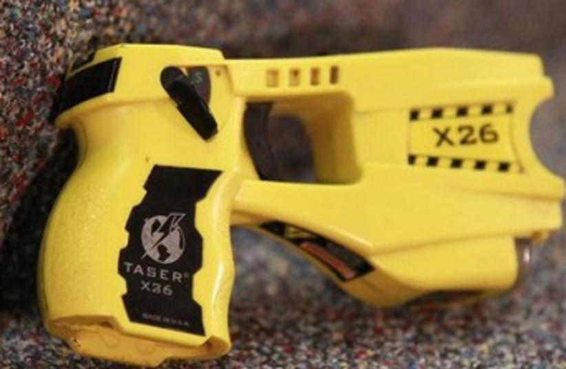 Taser gun (photo credit: Reuters)