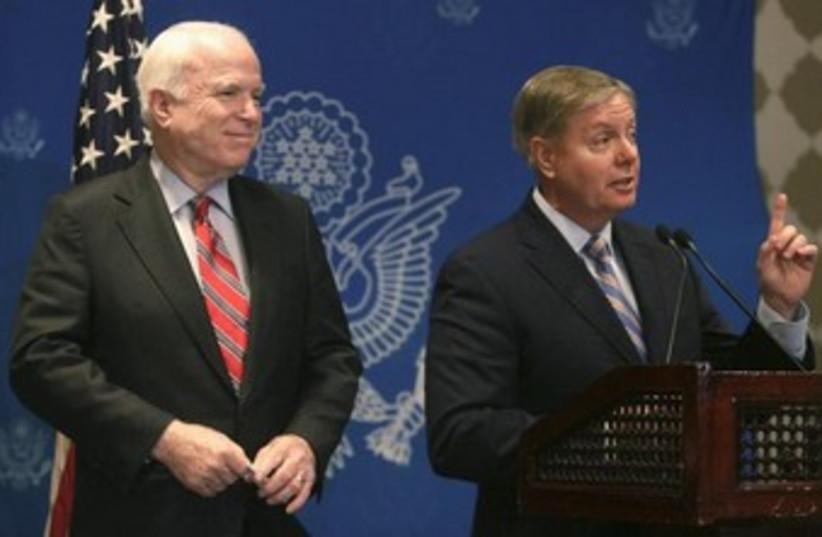 US senators John McCain and Lindsey Graham in Cairo 370 (photo credit: REUTERS/Asmaa Waguih)