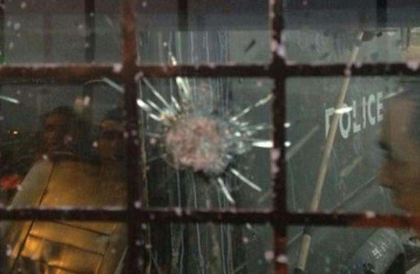 Shattered window in IDF vehicle 370 (photo credit: IDF Spokesman's Office)
