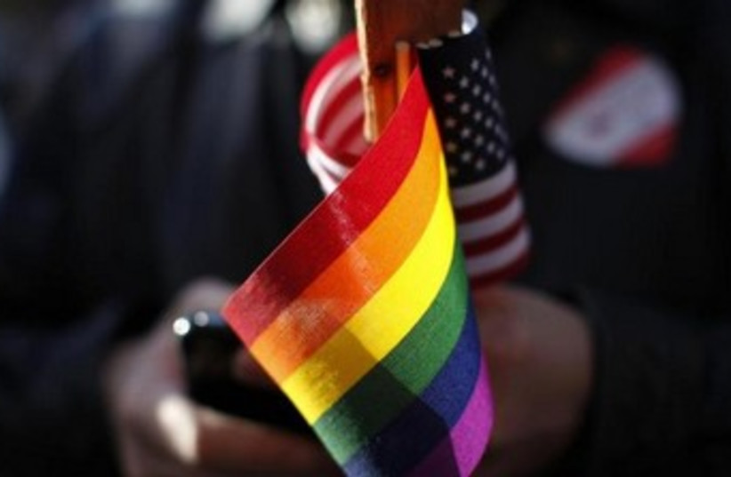 Gay pride and American flags 370 (photo credit: REUTERS/Stephen Lam)