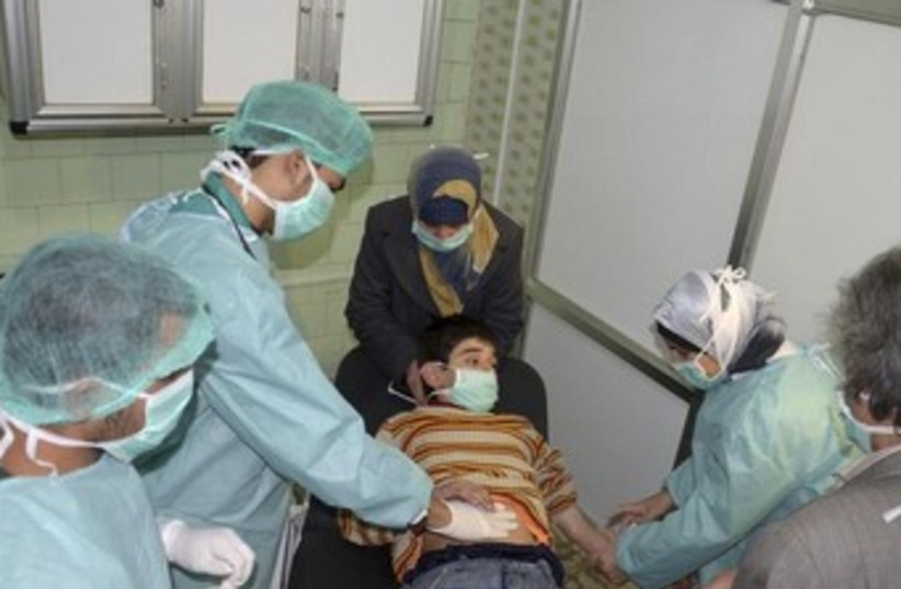 Boy affected by alleged chemical weapons attack in Syria 370 (photo credit: REUTERS)