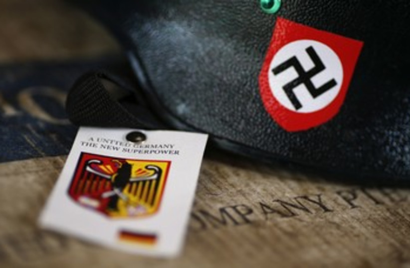 A motorcycle helmet with Nazi swastika sign for sale 370 (photo credit: reuters)