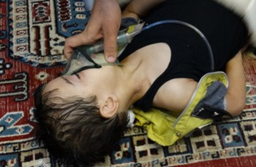 Boy allegedly affected by chemical weapons in Syria 370 (photo credit: REUTERS)