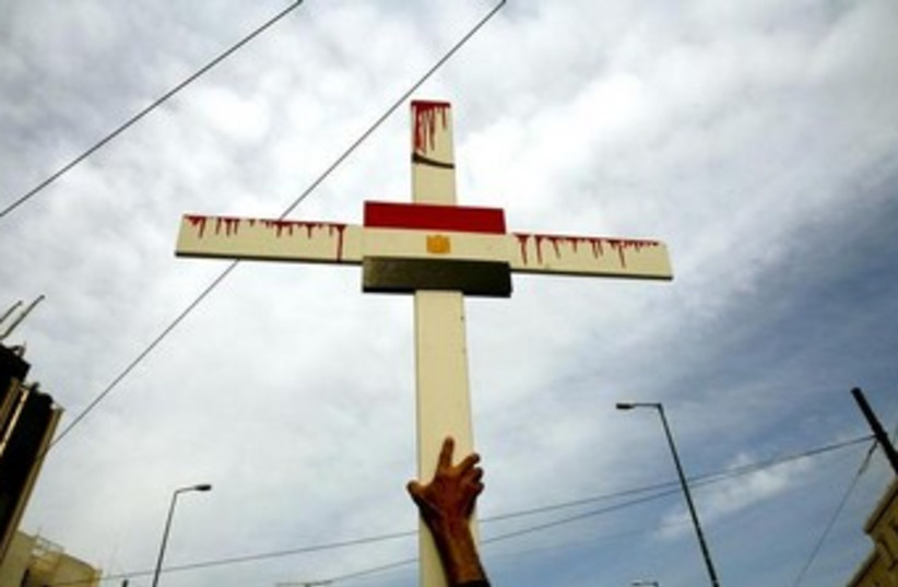egypt flag on cross 370 (photo credit: REUTERS)
