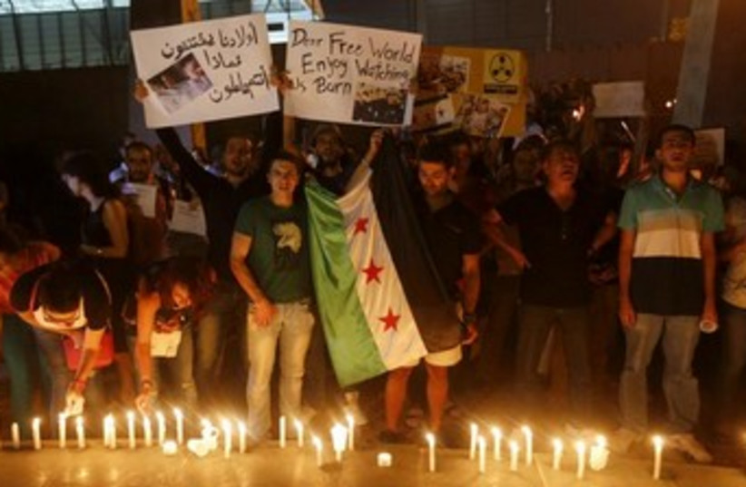 Syria vigil for chemical attack 370 (photo credit: REUTERS/Mohamed Azakir)