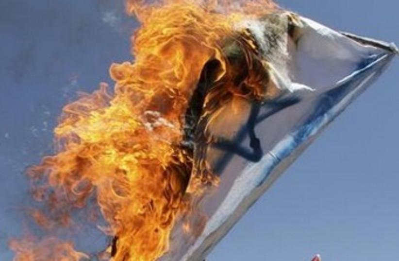 Burning Israeli flag 370 (photo credit: reuters)