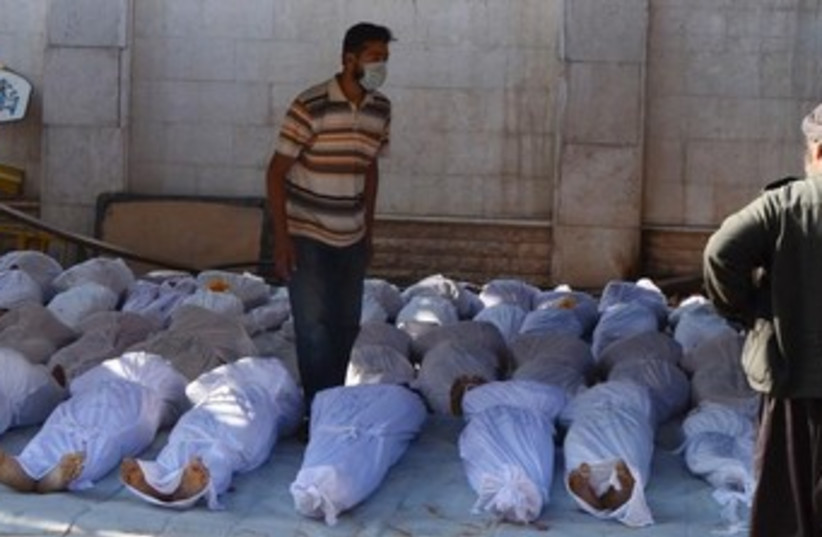 Bodies from Syria chemical weapons attack 370 (photo credit: REUTERS/Bassam Khabieh)