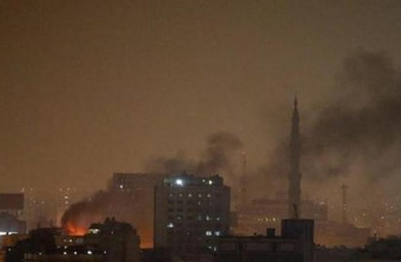 smoke rises at night in cairo 370 (photo credit: REUTERS)